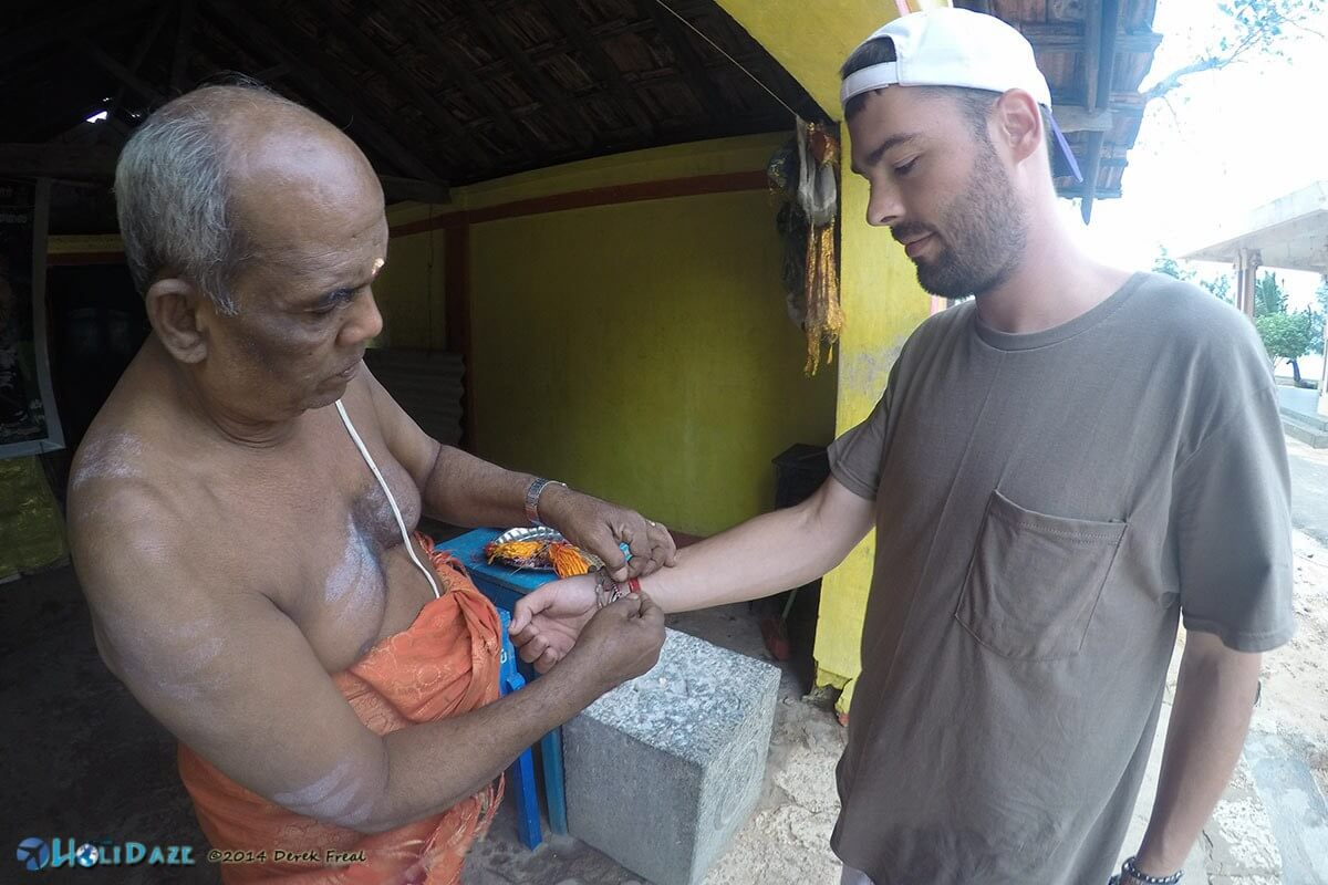 After getting blessed by a Hindu priest in Jaffna he attached a kalava to my wrist, which is supposed to ward off evil