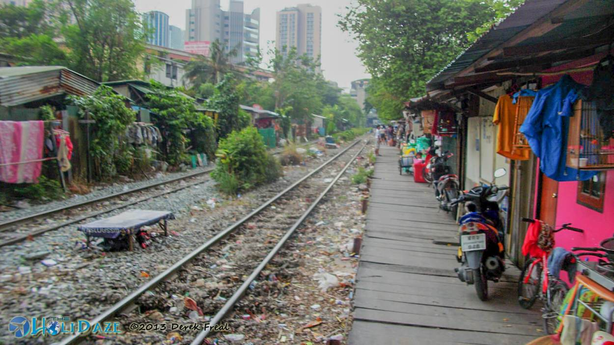 Walking along the Bangkok railroad track slums. Definitely not the land of smiles here.