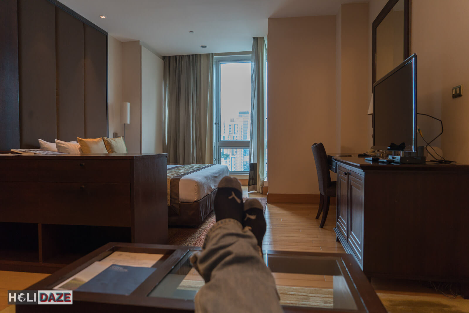 Relaxing in my suite at the Ascott Sathorn in Bangkok, Thailand