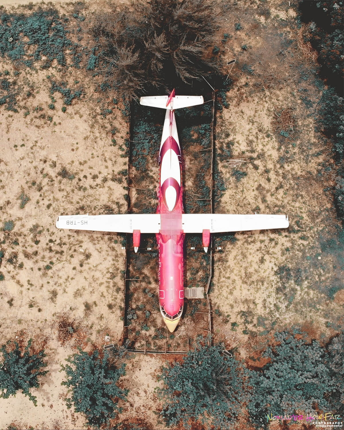 Aerial view of HS-TRB, the abandoned airplane on Mae Rumphueng Beach in Rayong, Thailand