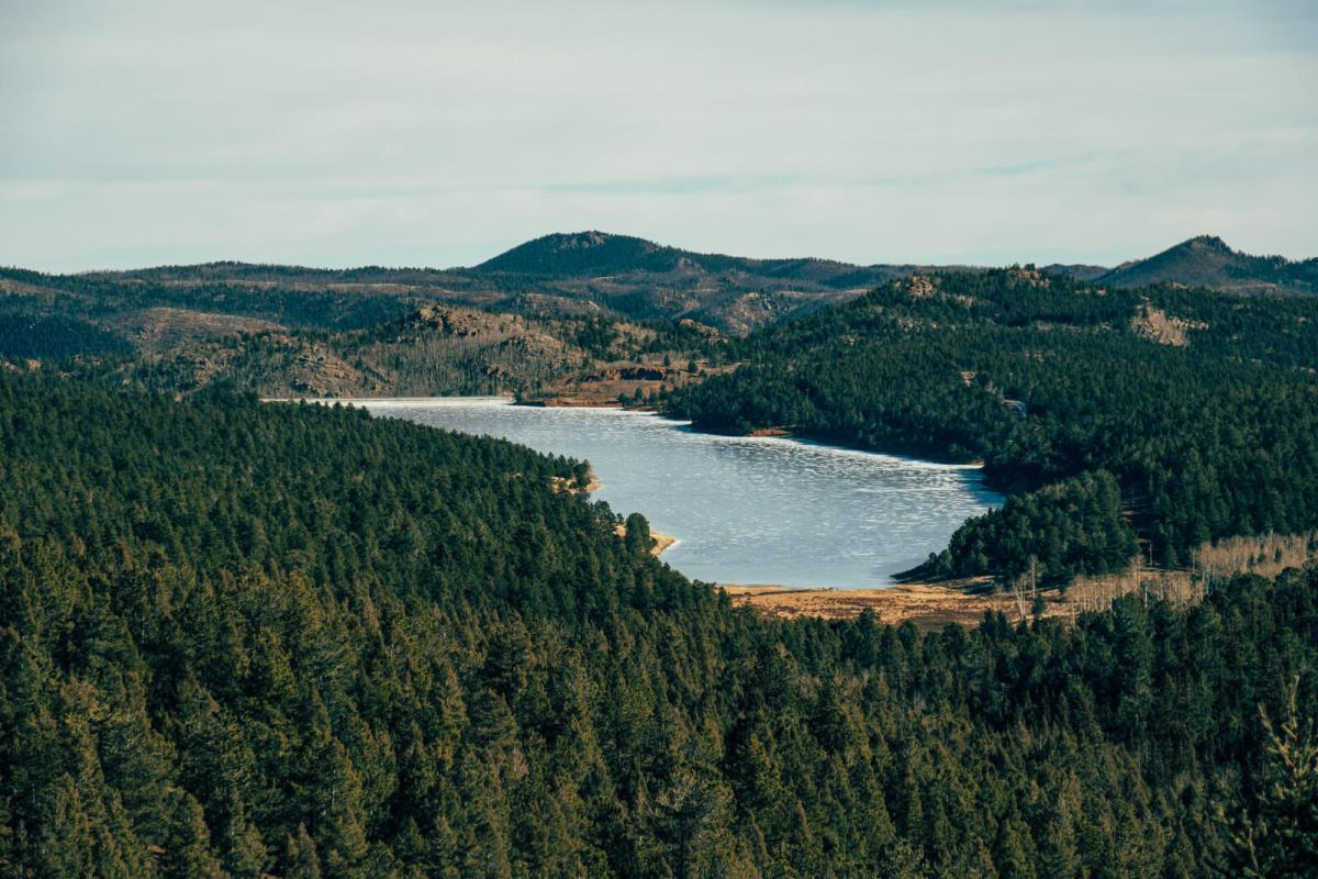 Pikes Peak Reservoir, aka Pikes Peak Lake, is located near mile marker 16 on the drive up Pikes Peak in Colorado