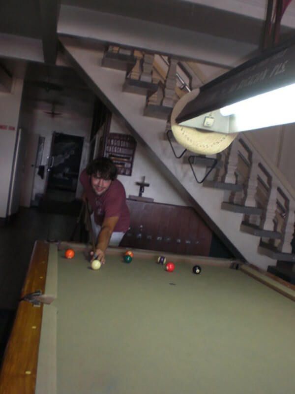 Derek Freal playing pool at Mango's Resort at Subic Bay in the Philippines