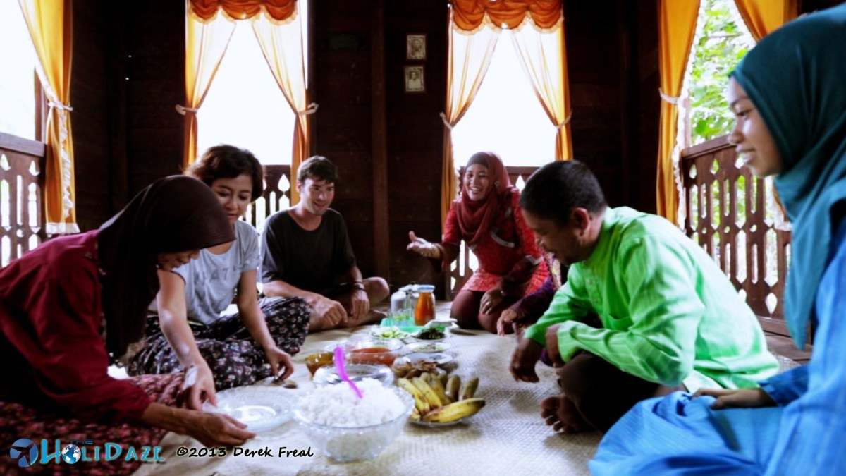 Eating lunch with a local family in Sumatra, Indonesia