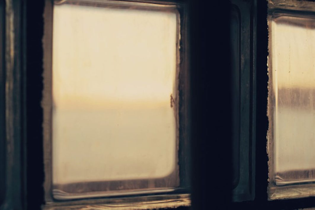 Sunset view through the frosted glass blocks of Alcatraz prison