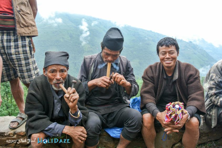 Smoking using a traditional Nepalese pipe