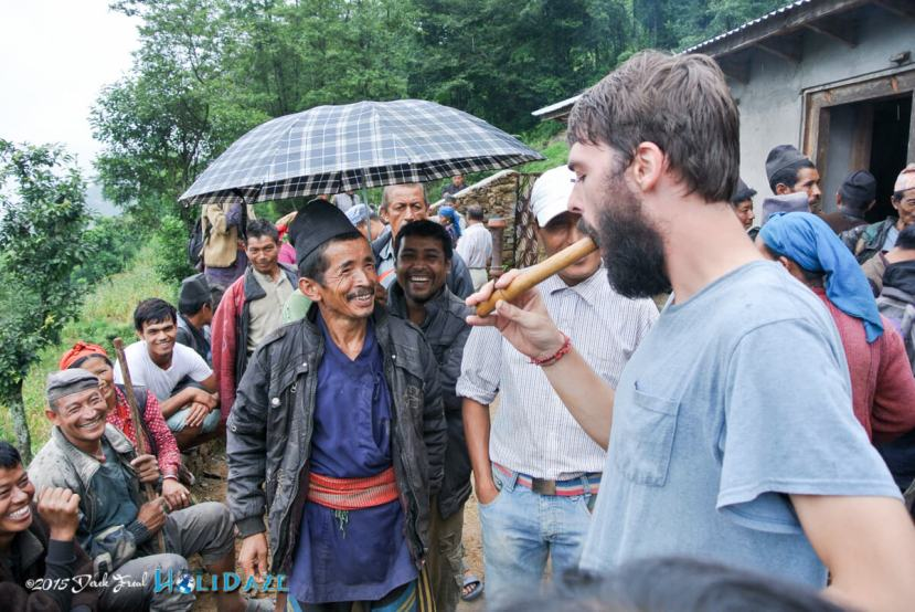 Derek Freal smoking a little grass with village locals in Nepal after the 2015 earthquake