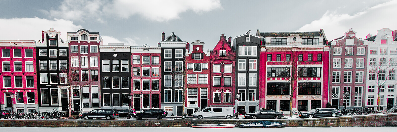 Colorful buildings in a frozen white Amsterdam winter -- welcome to the Netherlands