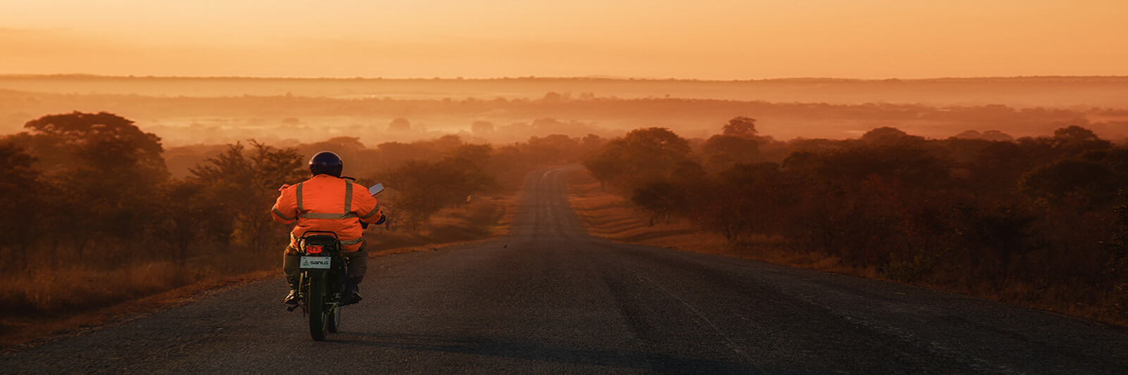 Motorcyclist on the Great East Road in Chinyunyu, Zambia