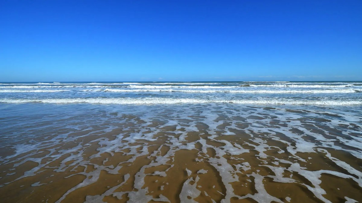 Blue skies and beaches at South Padre Island, Texas on the Gulf of Mexico
