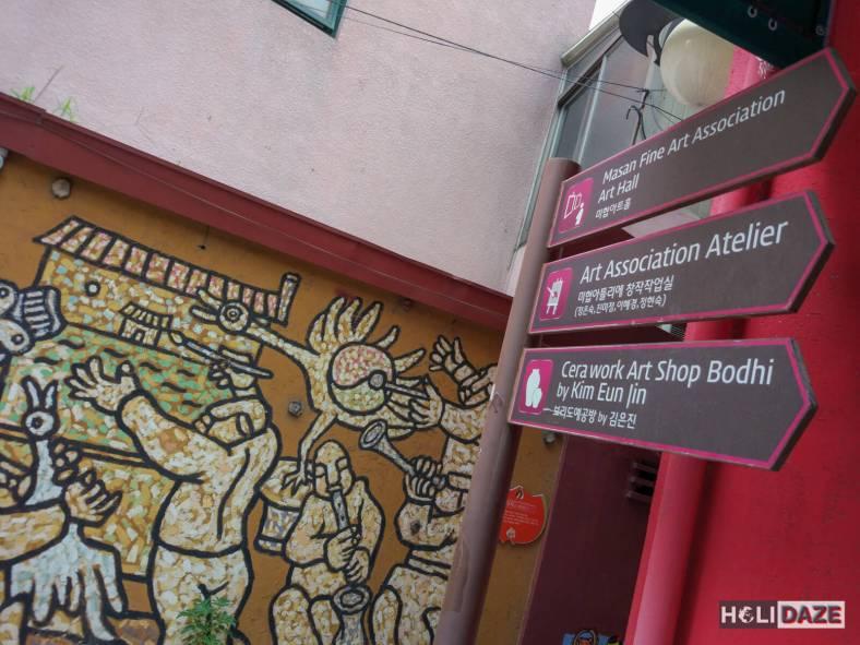 Street signs and street art at Changdong Art Village in Masan, Korea