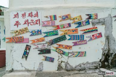 2,000 painted wooden fish adorn the walls of Gamcheon village in Busan, South Korea