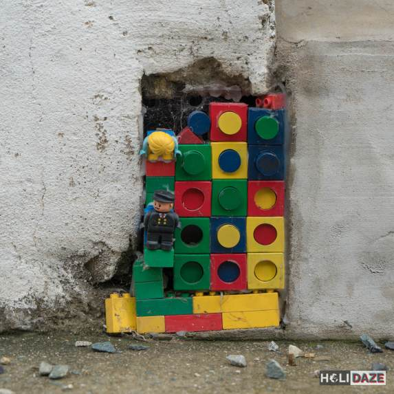 Close-up view of legos used to fill a crack in the cement sidewalk at Gamcheon Culture Village in Busan, South Korea