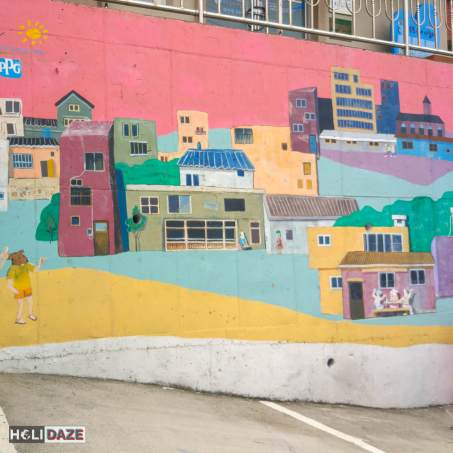 Urban art on the wall of a small parking lot at Gamcheon Culture Village in Busan, South Korea
