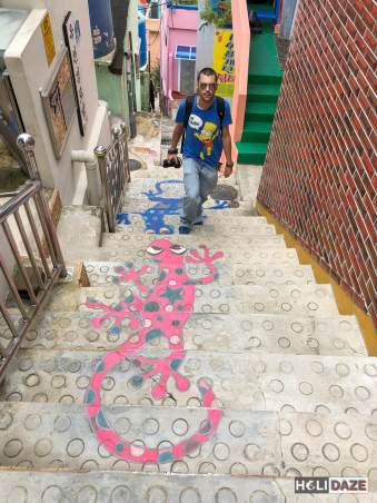Derek Freal climbing the Stairs To See Stars at Gamcheon Culture Village in Busan, South Korea