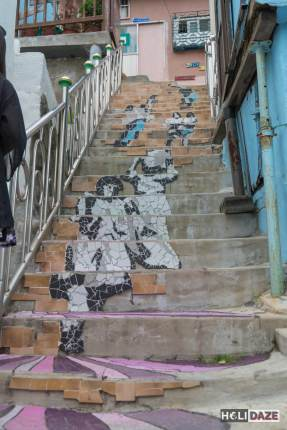 Dual murals decorate the Stairs To See Stars, one facing up and another down
