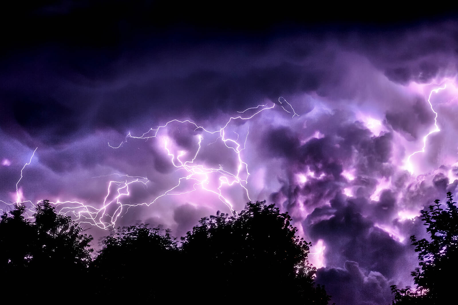 Unique meteorological phenomena like a purple lightning storm