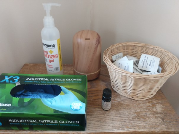 Nitrile gloves, alcohol swabs, hand sanitizer, and essential oils diffusing to keep our shoppers healthy