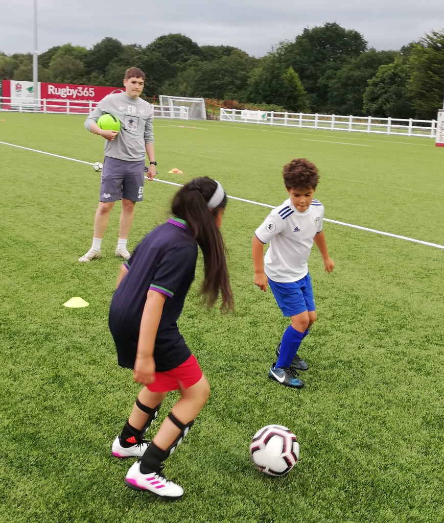 8 year olds receiving football coaching