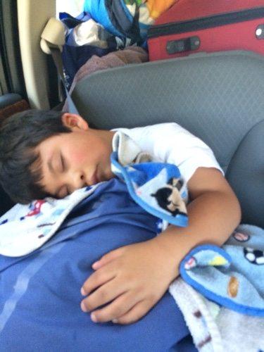 Zack sleeping in the car
