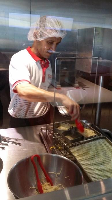 Our noodles getting a hot oil bath!