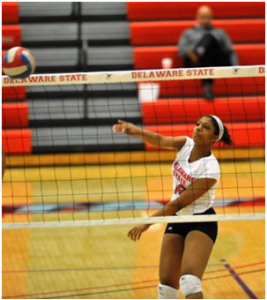 Maya Dunston serves the ball to her opponents. Photo Credit: DSUHornets