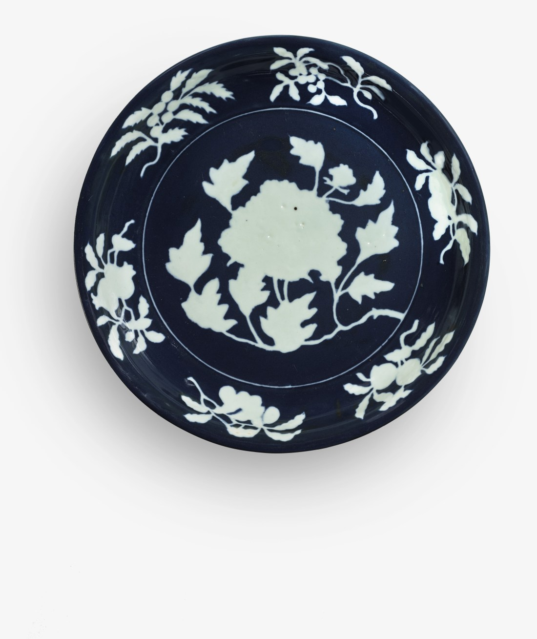 An exceptionally rare and large fine blue-and-white reserve decorated peony dish, estimated at $1 million to $1.5 million.