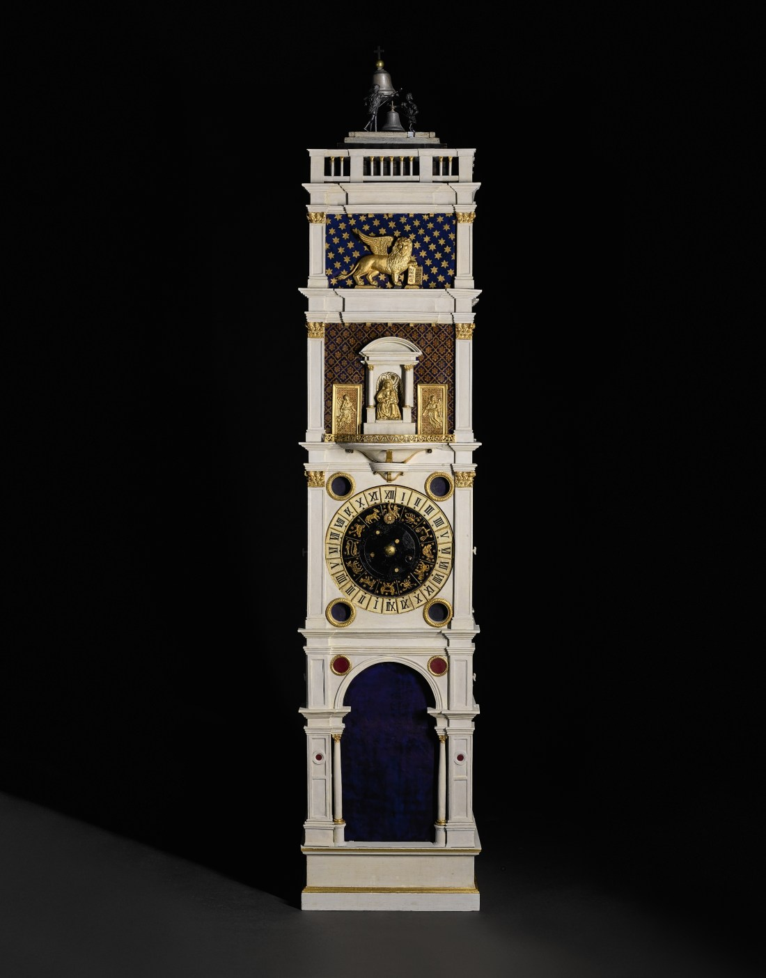 A painted and gilt copper model of the clock tower in Piazza San Marco, Venice. It stands nine feet, eight inches tall. The movement appears to date to the 18th century, and the case to the early 19th century.