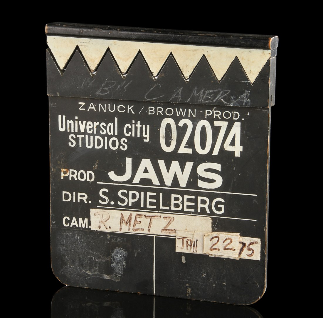 A wooden clapperboard that Steven Spielberg used on the set of the 1975 blockbuster horror movie, Jaws. Its clapper is shaped and painted to resemble a row of shark's teeth.