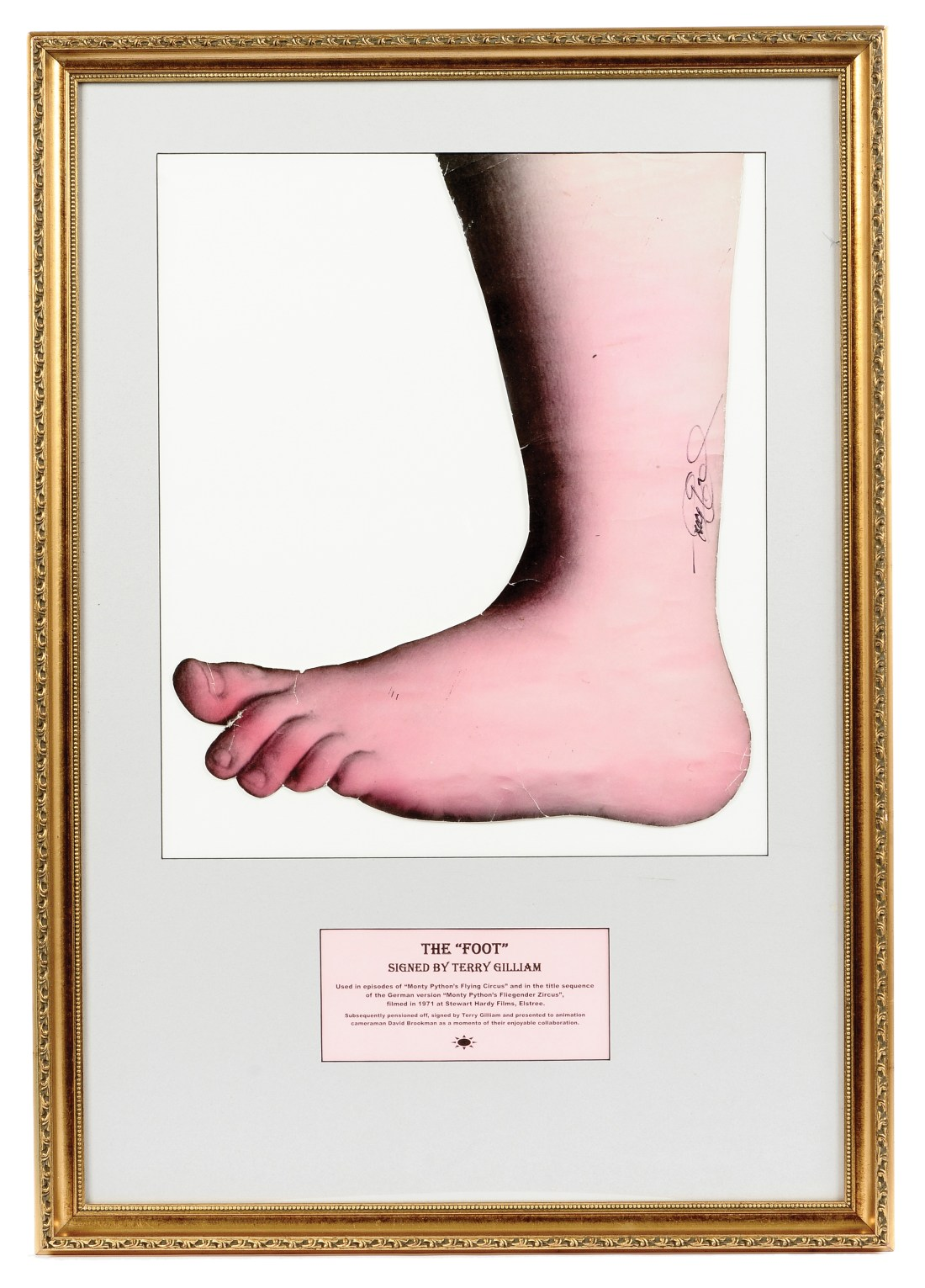 The Foot, aka the Monty Python foot, a paper cutout from an Old Master painting that Terry Gilliam blew up and used in the opening credits of Monty Python's Flying Circus. He signed this example on its ankle.