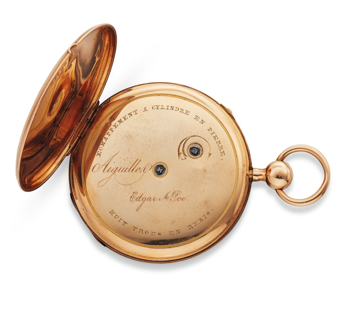 Edgar Allan Poe's 18-karat gold pocket watch, open to show that it has been engraved with his name.