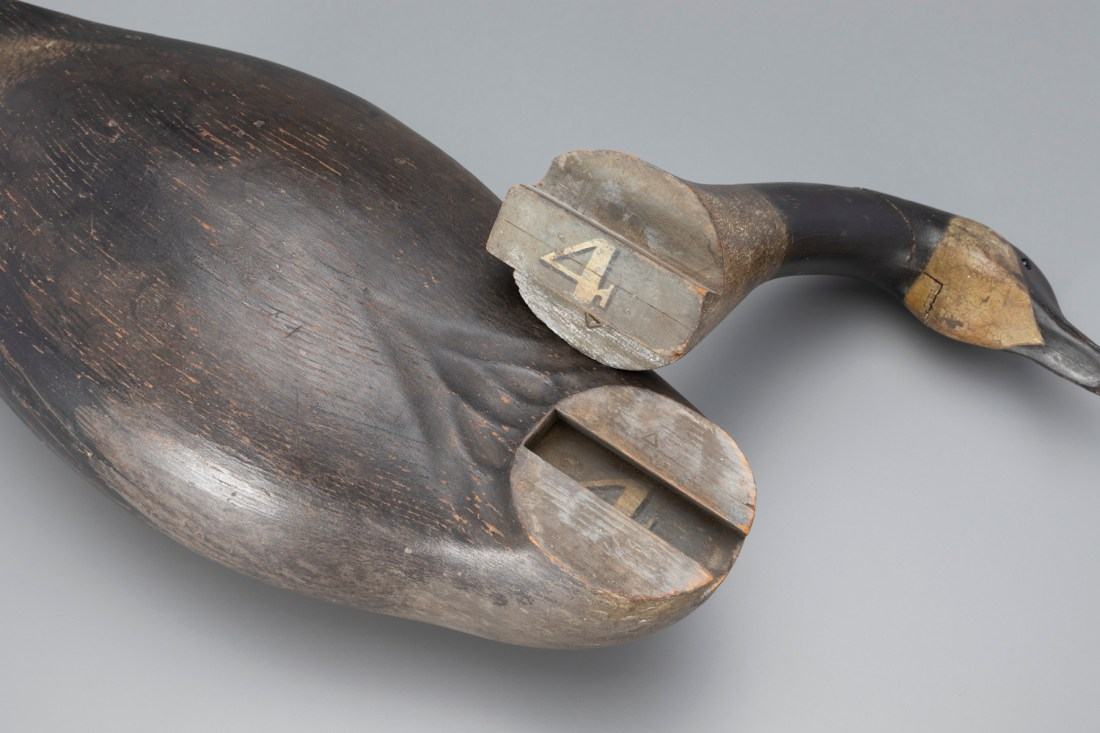 The Earnest-Gregory dovetailed goose decoy, with its head removed from the neck slot to show the unusual dovetail construction.