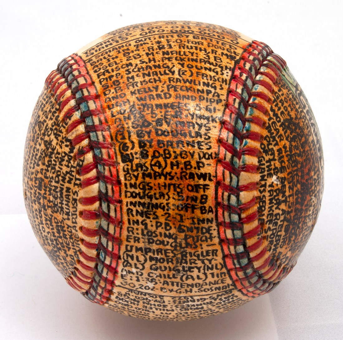 A baseball transformed by self-taught artist George Sosnak. This angle showcases how tightly Sosnak crammed the ball's surface with information about how the 1921 World Series played out.