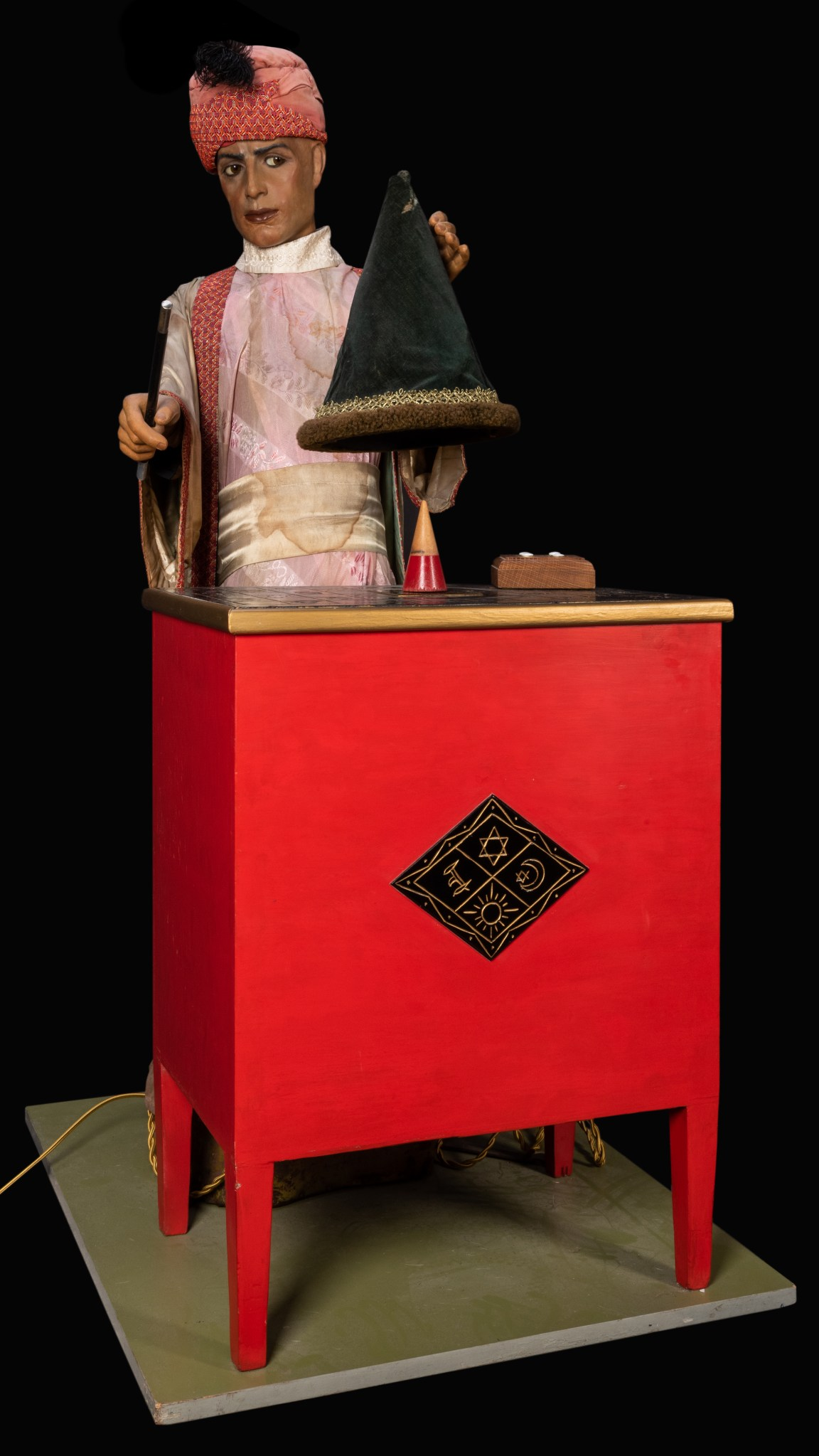 A circa 1925-1930 magician automaton that appeared in the 1972 film Sleuth, which starred Laurence Olivier and Michael Caine. It stands 56 1/2 inches tall and performs eight movements.