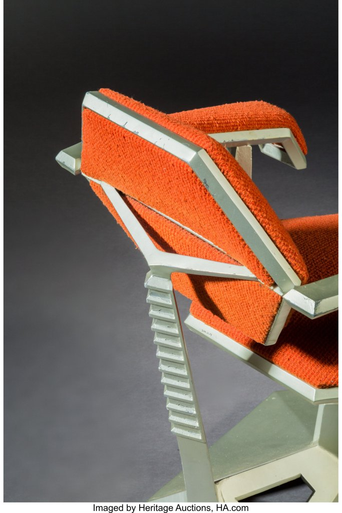 A detail shot of the Frank Lloyd Wright Price Tower armchair, showing the spine-like appearance of the back strut.