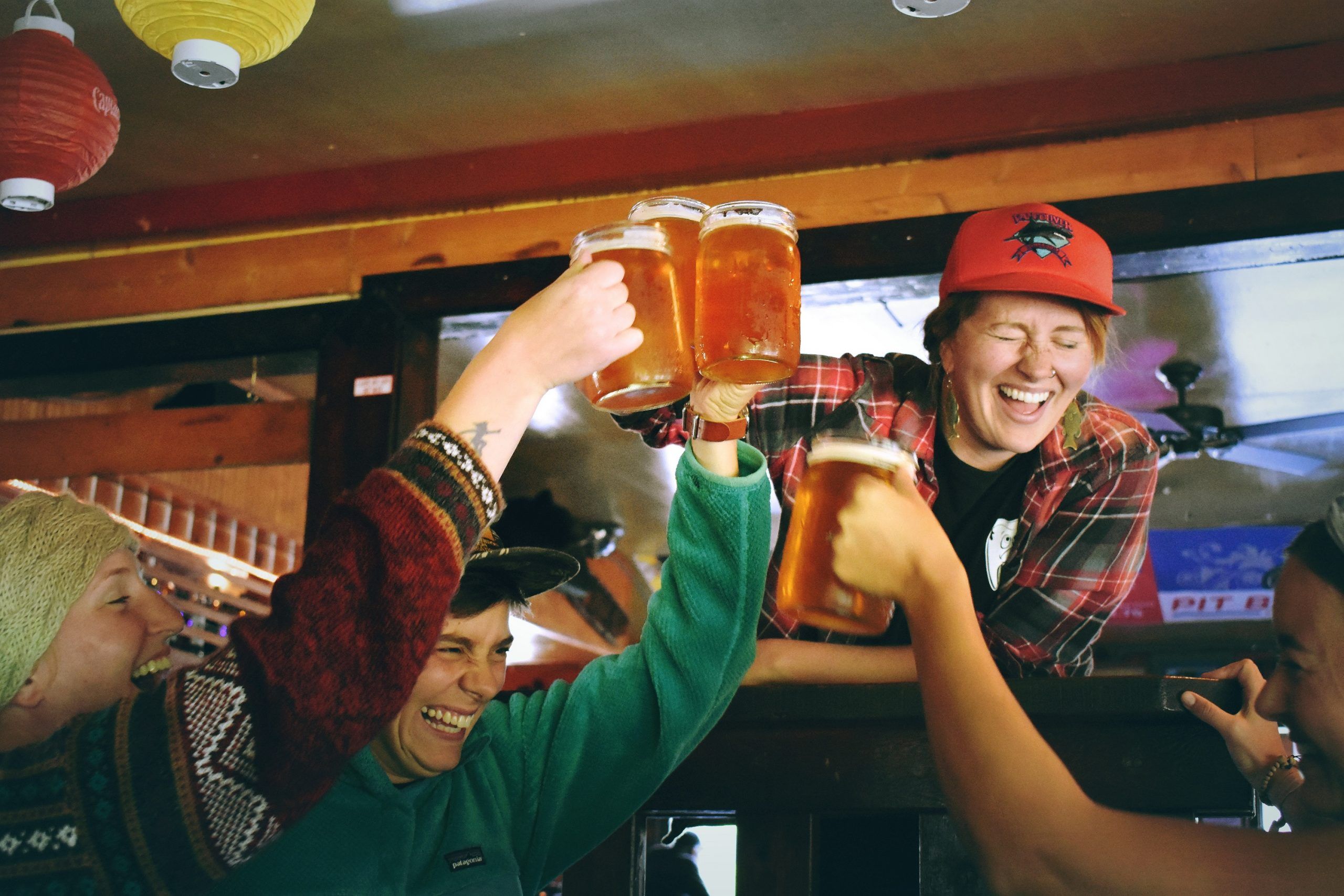 hazing, laughing people with beer mugs