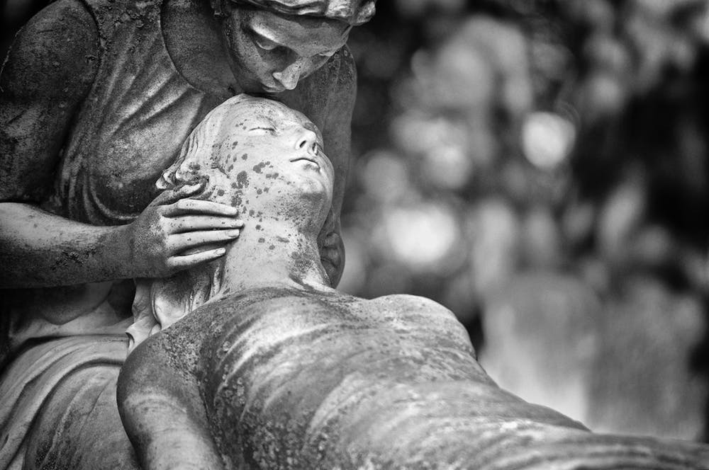hospice care, statue of woman kissing forehead of deceased