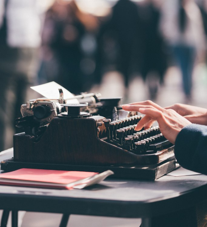 national novel writing month, fingers on old typewriter