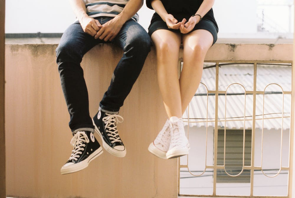 teenage dating slang, kids' legs dangling