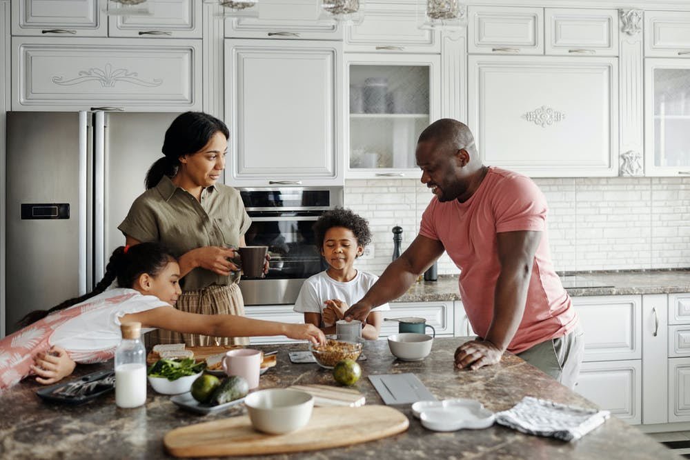 Fun things to do with grand-kids, African American couple and two children in kitchen