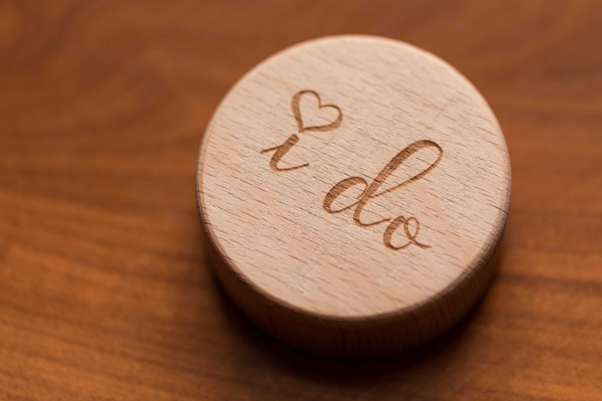 "wedding, wooden disc with ""i do"" on it"