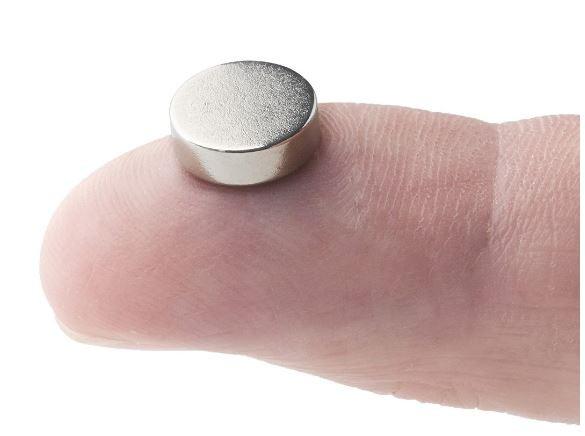 Magnets, finger and magnet