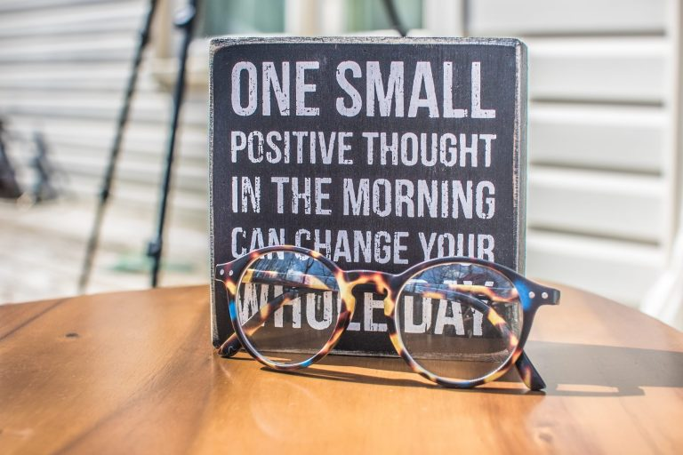 Positive thinking, note and glasses