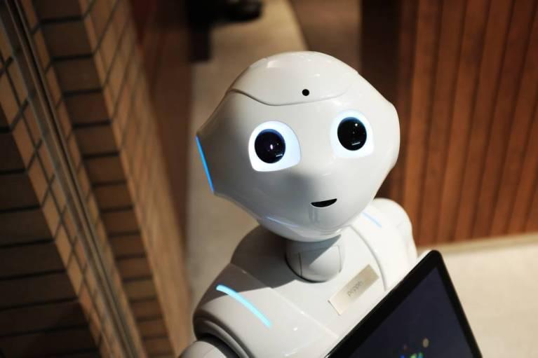 robots, white robot with big, dark eyes
