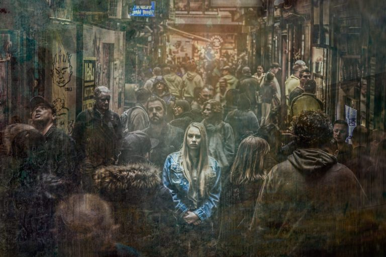Loneliness, woman in crowd