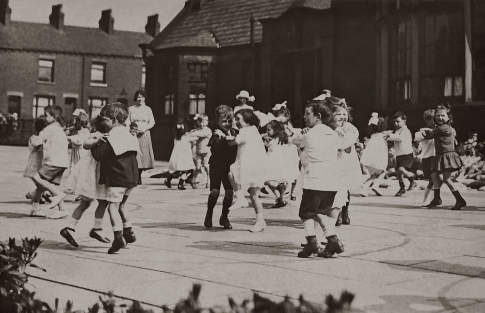 re-opening schools, black and white photo of old time school recess