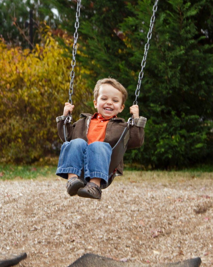 Backyard swing, happy boy