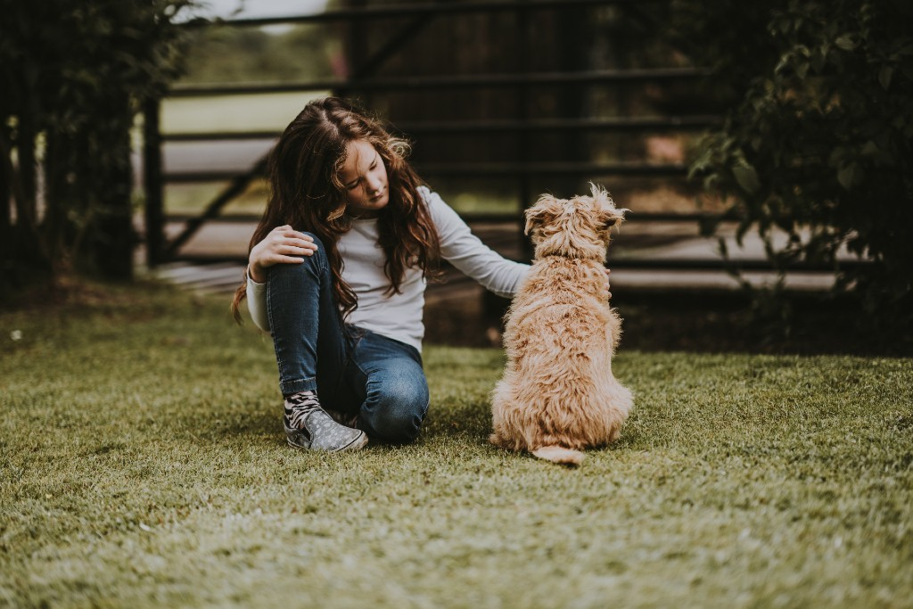Feeling down, woman and dog outside