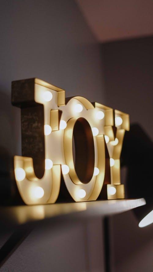 live a happier life, joy sign with lightbulbs lit