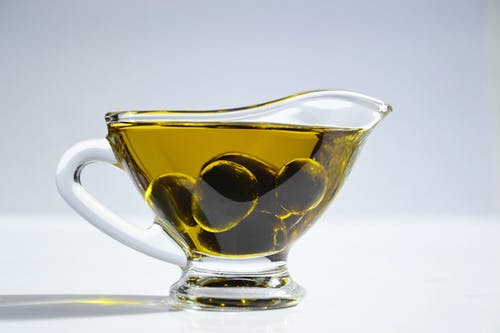 whiten teeth, cup of olives and olive oil