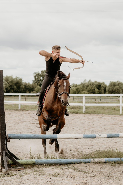 hidden talent, man on horseback with bow and arrow